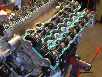 The cylinder heads are massive, housing 2 overhead cams each. Intake is directly from each carb throat (15089).