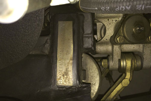 The serial number is stamped into the frame near the right front suspension (s/n 16057).