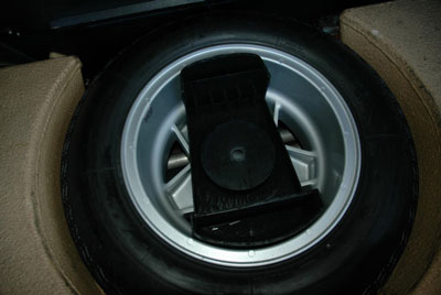 Toolkit carrier in spare tire